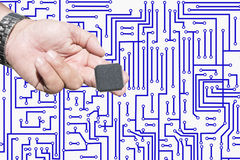 Integrated circuit in hand Stock Photo