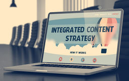 Integrated Content Strategy on Laptop in Conference Hall. 3D. Royalty Free Stock Photo