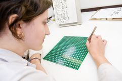 Integrated microcircuit chip worker Stock Photos