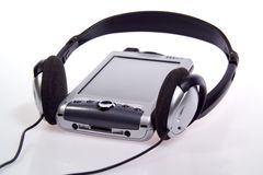 Integrated PDA, Cell Phone and MP3 Player. Integrated cell phone and pda with headphones on white background stock image