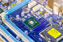 Integrated semiconductor microchip/ microprocessor on blue circu. It board representative of the high tech industry and computer science Royalty Free Stock Image