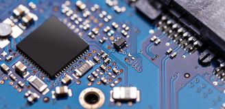 Integrated semiconductor microchip. / microprocessor on blue circuit board Stock Photos