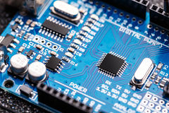 Integrated semiconductor microchip. / microprocessor on blue circuit board Stock Photography