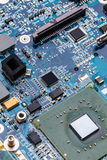 Integrated semiconductor microchip. /microprocessor on blue circuit board Stock Image