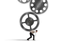 Integration concept with gears system mechanism. Businessman holding with fatigue a gears system mechanism Stock Image