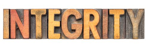 Integrity word in vintage wood type stock photos