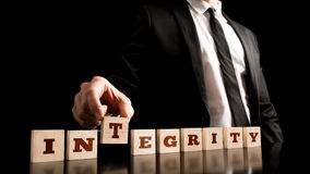 Integrity On Wooden Piece Arranged By Businessman Royalty Free Stock Photo