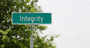 Integrity Street Sign. Having integrity is the adherence to moral and ethical principles; soundness of moral character; honesty Royalty Free Stock Photos