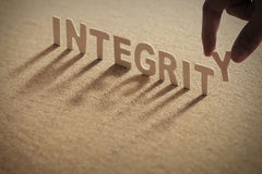 INTEGRITY wood word on compressed board Royalty Free Stock Photo