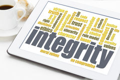 Integrity word cloud on digital tablet Royalty Free Stock Photos