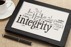 Integrity word cloud on digital tablet Royalty Free Stock Images