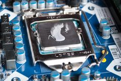 Intel core processor i5 with gray thermal paste on motherboard stock photography