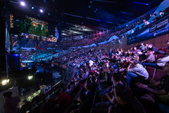 Intel Extreme Masters 2014, Katowice, Poland. Full audience in Spodek arena at IEM 2014, 14th - 16th March in Katowice, Poland. Big screen with League of Legends Royalty Free Stock Photos