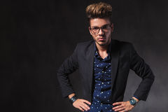 Inteligent handsome man wearing glasses pose in dark studio with Royalty Free Stock Photography