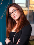 Intellectual Business Woman Wearing Glasses Head Tilted Royalty Free Stock Photography