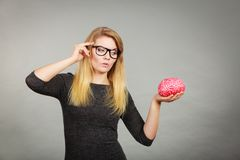Woman thinking and holding fake brain Stock Photos