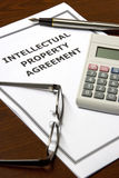 Intellectual Property Agreement. Image of an intellectual property agreement on an office table Royalty Free Stock Photo