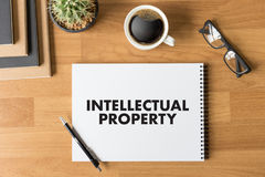 INTELLECTUAL PROPERTY Business team hands at work with financial. Reports and a laptop royalty free stock photos