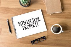 INTELLECTUAL PROPERTY Business team hands at work with financial Stock Photography