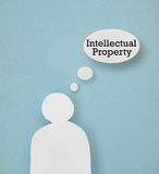 Intellectual property. Paper cutout figure with Intellectual Property thought bubble Royalty Free Stock Photo