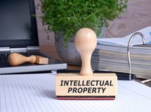 Intellectual Property Stamp in the Office. With binder and laptop in the background Stock Photography
