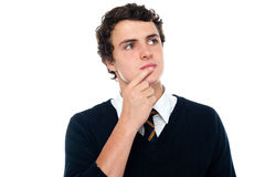 Intellectual student recollect the answer Royalty Free Stock Images
