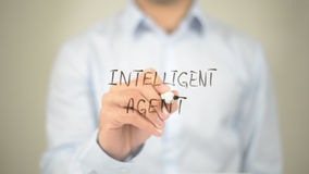 Intellegent Agent , Man writing on transparent screen Royalty Free Stock Images