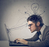 Intelligence. Young man working with laptop Royalty Free Stock Photography