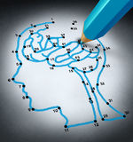 Intelligence Therapy. And brain research challenges as a medical concept with a connect the dots drawing puzzle connected by a blue pencil representing a doctor Stock Photos