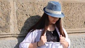 Intelligens för tonårs- flicka en hatt Arkivfoton