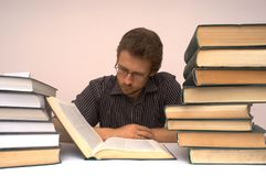 Intelligent. An image of man with books Royalty Free Stock Photography