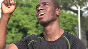 Intelligent African male athlete having an idea. A handsome young black male stock video footage