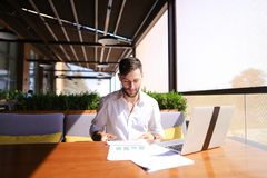 American financier working with laptop and diagram documents at Royalty Free Stock Image