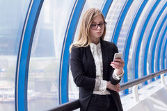 Intelligent business woman corresponds with the client by phone Stock Image
