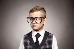 Intelligent child in glasses.elegant kid Royalty Free Stock Photo