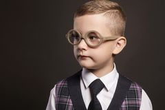 Intelligent child in glasses. Stylish little smart boy in suit Stock Photos