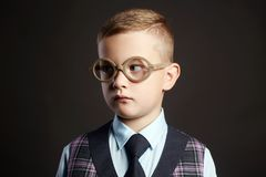 Intelligent child in glasses. kid. Intelligent child in glasses. funny little boy in suit and glasses. elegant kids Royalty Free Stock Images
