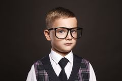 Intelligent child in glasses. Little boy in suit and glasses.elegant kid Stock Photos