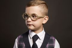 Intelligent child in glasses. Stylish little smart boy in suit Royalty Free Stock Photo