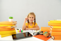 Intelligent child sitting at the desk with books royalty free stock photos