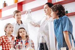 Intelligent curious children looking at the chemical flask Stock Photo
