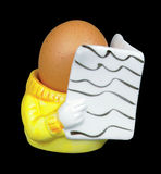 Intelligent egg!. Person shaped egg cup with egg reading stock images