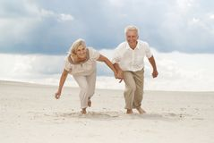 Intelligent elderly couple enjoy the sea breeze Stock Images