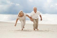 Intelligent elderly couple enjoy the sea breeze Stock Images