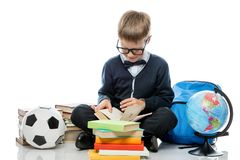 Intelligent elementary school student with books. On a white background stock images
