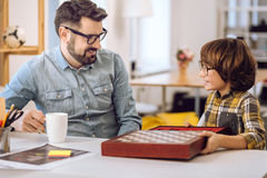 Intelligent father and son looking to each other Royalty Free Stock Photo