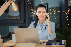 Intelligent female doctor discussing work on the phone stock photo