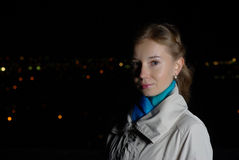Intelligent Girl in a coat in night city Royalty Free Stock Images