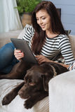Intelligent graceful woman reading at her free time Stock Photography