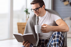 Intelligent handsome man reading a book Royalty Free Stock Images
